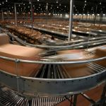 Boxes On A Conveyor Belt In A Manufacturing Plant